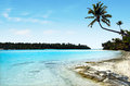 Landscape of one foot island in aitutaki lagoon cook islands view Royalty Free Stock Photo