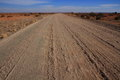 Landscape with open dusty dirt road Royalty Free Stock Photo