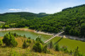 Landscape with pedestrian bridge at river Uvac gorge Royalty Free Stock Photo