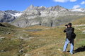 Landscape photographer at matterhorn hiking trail near schwarzsee switzerland Royalty Free Stock Photography