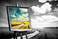 Landscape picture painted on canvas against black and white field Royalty Free Stock Photo
