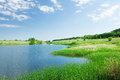 Landscape with pond and hills Royalty Free Stock Photo
