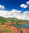 Landscape with red cliffs and dramatic blue sky Royalty Free Stock Image