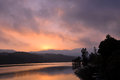 Landscape of reservoir and mountains at twilight sunset. Royalty Free Stock Photo