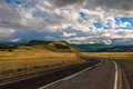 Landscape with road steppe mountains on the horizon cloudy sk evening a in sky and evening lighting Royalty Free Stock Image
