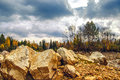 Landscape with rocks in the foreground harsh Royalty Free Stock Photography