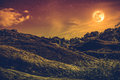 Landscape of sky with many stars and beautiful full moon. Sepia Royalty Free Stock Photo