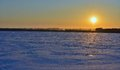 Landscape of a snow-covered field and sunset Stock Photography