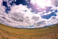 Landscape steppe sky clouds the altai russia with a or semi desert mountains at the horizon and cloudy blue image was taken with Stock Photos
