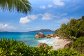 Landscape with tropical beach coastline palms granite rocks island seychelles la digue Stock Photography