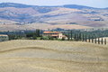 Landscape in tuscany with luxury villa and cipress Royalty Free Stock Images
