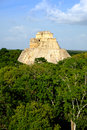 Landscape vertical view of Uxmal archeological site with pyramid Royalty Free Stock Photo