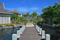 Landscape view of beautiful upscale resort hotel with small wooden bridge connecting the walkway with the villas suitable settings Stock Images