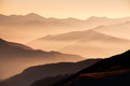 Landscape view of misty mountain hills at sunset Royalty Free Stock Photo