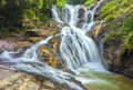Landscape waterfall flowing into soft silk sheet Royalty Free Stock Photo