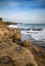 Landscape of waves crashing onto rocks during beautiful winter s seascape day Stock Photography