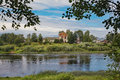 Landscape with wide russian river and the ruins of an ancient temple a navigable overgrown reeds orthodox church destroyed by Royalty Free Stock Images
