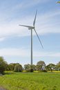 Landscape of wind turbine in rape field Royalty Free Stock Photo