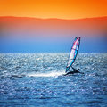 Landscape with windsurfer silhouette against a sunset background Royalty Free Stock Photos