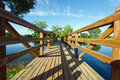 Landscape with wooden bridge and river Stock Images