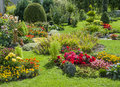 Landscaped flower garden beautiful with blooming seasonal flowers Royalty Free Stock Photo