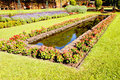 Landscaped Formal Garden With Rectangular Fish Pond Royalty Free Stock Photo