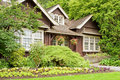 Landscaped log cottage in woods Royalty Free Stock Image