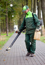 Landscaper cleaning the track using Leaf Blower Royalty Free Stock Photo