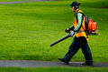 Landscaper operating petrol Leaf Blower Royalty Free Stock Photo