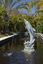 Landscaping dolphin water fountain a beautiful landscape in a large pond Royalty Free Stock Photography