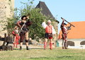 Landsknecht soldiers getting ready for shooting from hand guns Royalty Free Stock Photo