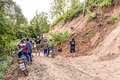 Landslide chiang mai thailand october peoples help together clear tree and soil on local road because of on october in omkoi Royalty Free Stock Photos