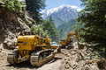 Landslide in the himalayas gangotri uttarakhand circa may bulldozers clear fallen earth after a on a road gangotri circa may Stock Image
