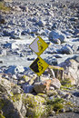 Landslide sign a about ice and stones in a rocky river in new zealand Royalty Free Stock Photo
