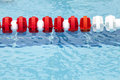 Lane divider, pool marker lines. Blue clean water Royalty Free Stock Photo