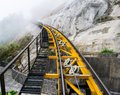 Lane railway runs skyward on forest Stock Photos