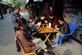 Langzhong china people playing cards is a popular pastime for shopkeepers seated at a table in front of a store on shuangzhazi Royalty Free Stock Photo