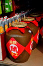 Langzhong china vinegar urns large clay and smaller plastic bottles filled with the famed local chu are displayed in a food shop Stock Image