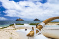 Lanikai outrigger an canoe sits at the shore of beach in front of na mokulua islands on oahu hawaii Stock Images