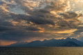 Lanscape of sunset over mountains and sea Royalty Free Stock Photo
