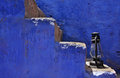 Lantern on a blue staircase Royalty Free Stock Photo