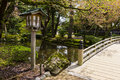 Lantern and bridge in Kenroku-en gardens Royalty Free Stock Photo