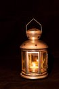 Lantern candle burning in a on black background Royalty Free Stock Photos