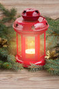 Lantern with glowing candle and fir tree christmas red evergreen cones Royalty Free Stock Photography
