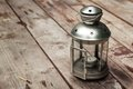Lantern old and a match on a wooden table Royalty Free Stock Image
