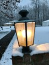 A lantern in the midst of a mild suburban winter scene Royalty Free Stock Photo