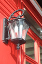 Lantern on a red wall decorative old fashioned style Stock Photos