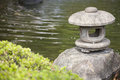 The lantern rock of japan style in the garden with detail Stock Photo