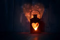 Lantern st valentine s day greeting card with candle and hearts Stock Photography
