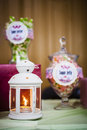 Lantern with sweets and snacks a along some on table in wedding reception party Stock Photo